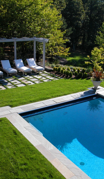 Stone-clad blue with lawn surround